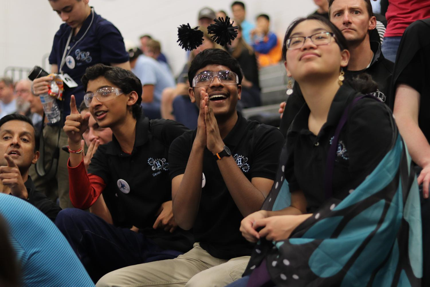 Sophomore Devan Ravani and freshman Nitin Balasubramanian cheer in the stands for their team, Metal Morphosis, during semi-finals.