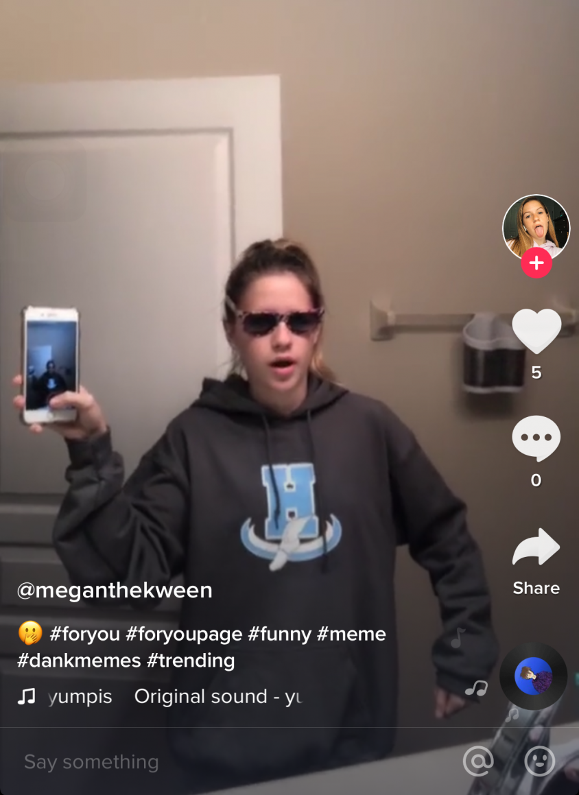 Freshman Megan Lundstrom  recreates a TikTok meme from user 'Yumpis.' TikTok allows users to pick their own sound, which could be another TikTok. This feature gives users like Lundstrom, freedom to use their originality to recreate trending TikToks.