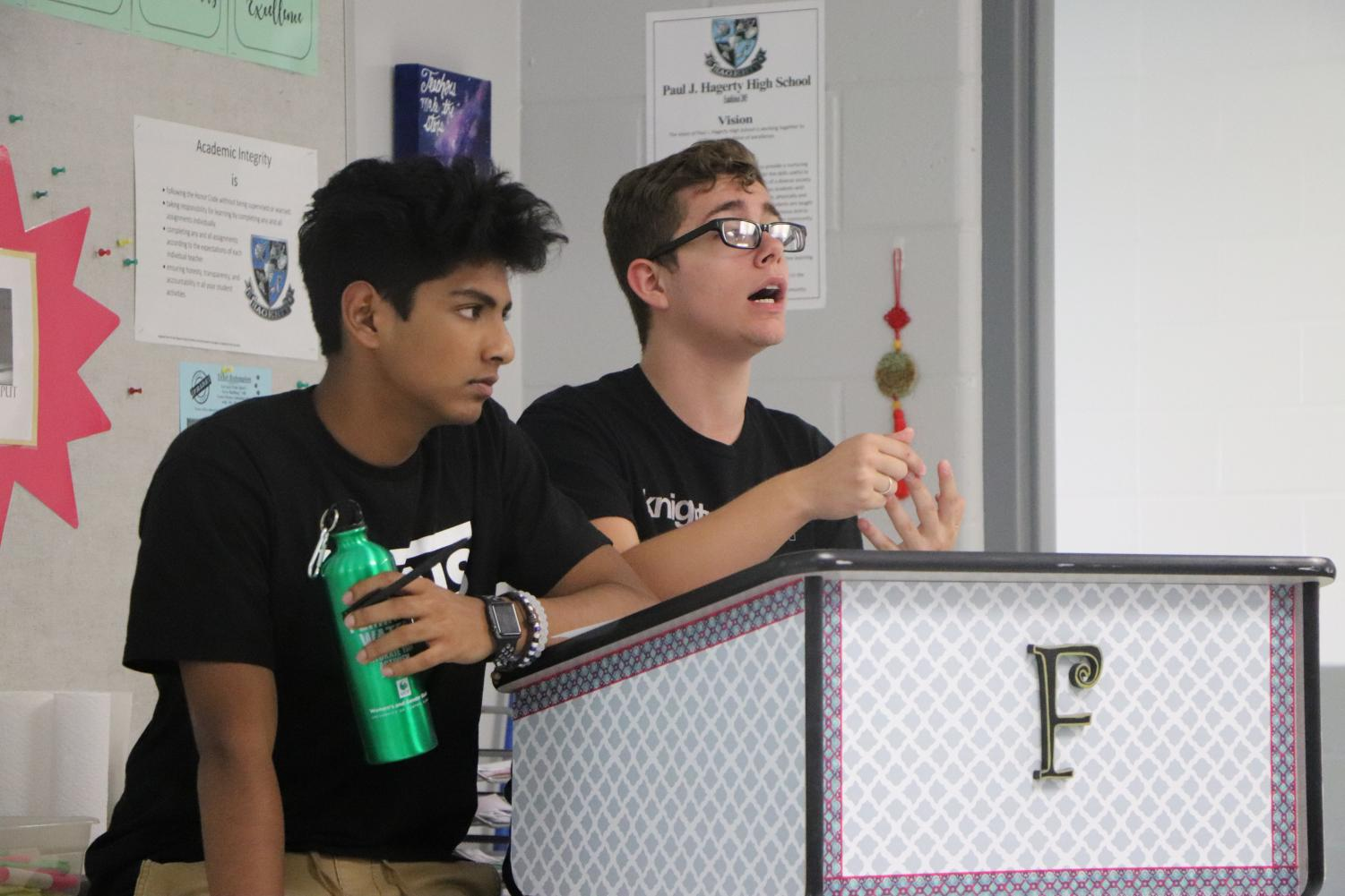 Talking to the club about current events, senior Michael Mcnamara and junior Artie Nayak were trying to explain to members the news of the week.