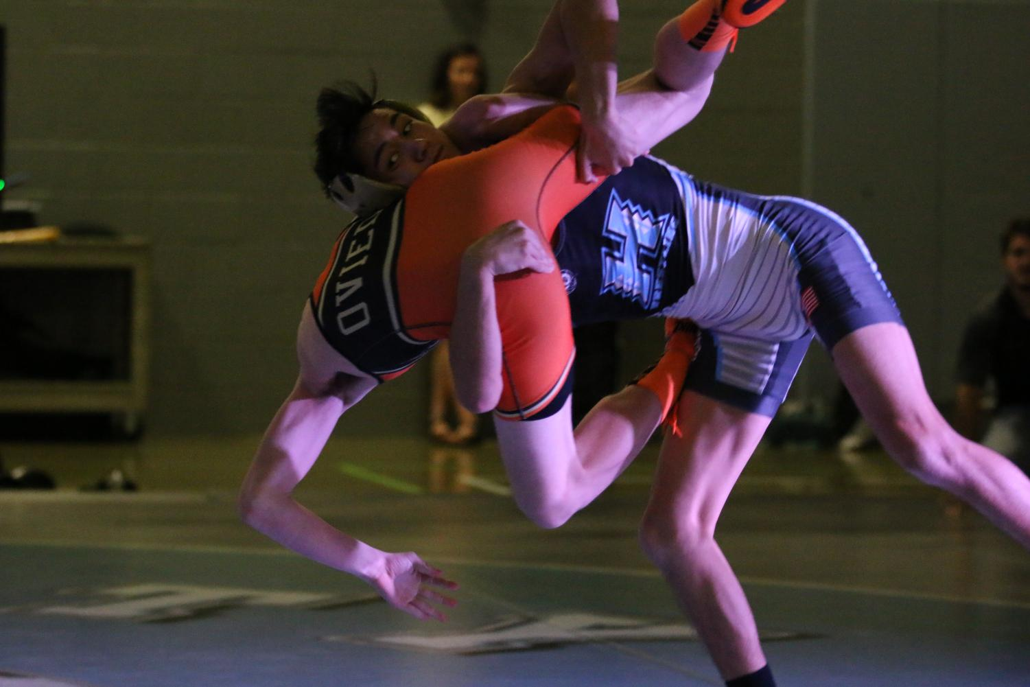 Senior Ryan Rowland on his way down with his opponent, from Oviedo. He would slam and pin his opponent for the win.