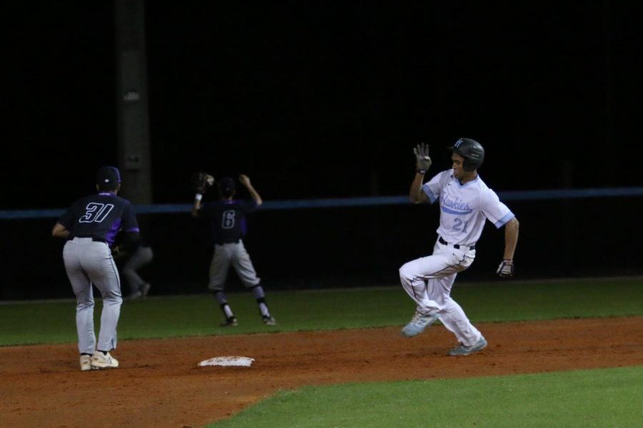 Center fielder Riley Greene rounds second base in the first at bat of the year. Greene would make it to third base, going 1-3 at the plate.