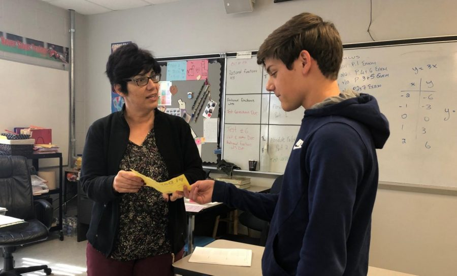Sophomore Michael Rygh turns in his Pi Day form. Math teacher Aglaia Christodoulides, along with several other teachers, handed these slips out for students to select the pies they wished to purchase.