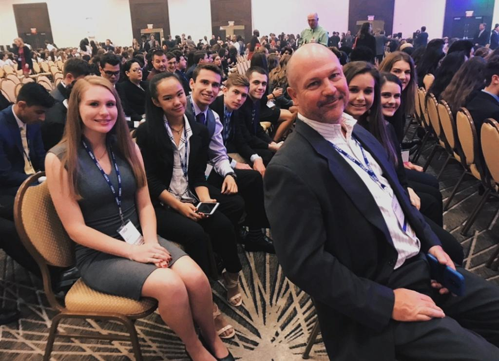 DECA club awaits for the awards ceremony to start. Last year, only three members of the club qualified for states and attended, but, this year, DECA tripled their members, with nine students who attended and four award winners.