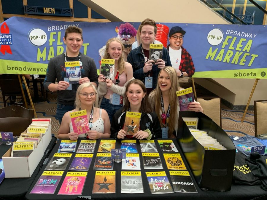 Troupe members take picture with famous musical playbills.