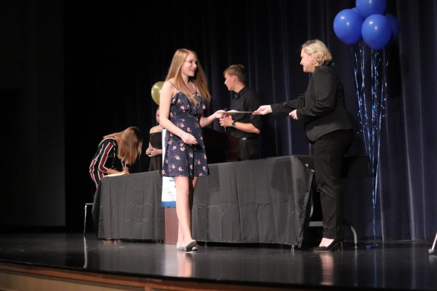 Laura+Darty+walks+up+on+stage+during+the+ceremony+to+receive+her+award.+72+members+were+inducted+this+year.