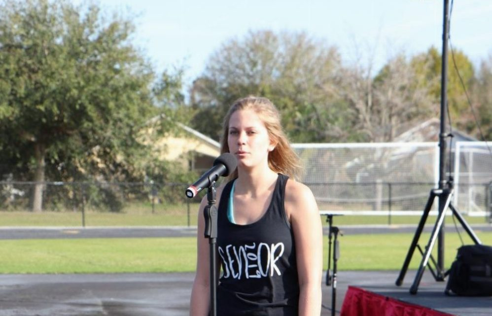 Senior Sami Vincent performing the national anthem at the annual Pals Autism Walk. She will be performing blank blank at the Youth Advisory talent show on May 23.