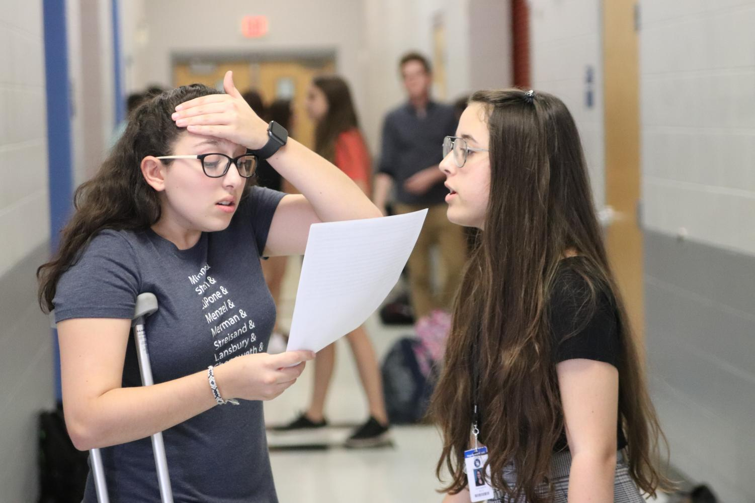 Sophomore Olivia Martin and freshman Lily Joseph practice lines for Joseph's upcoming audition. She ended up landing the part of Mary Warren.