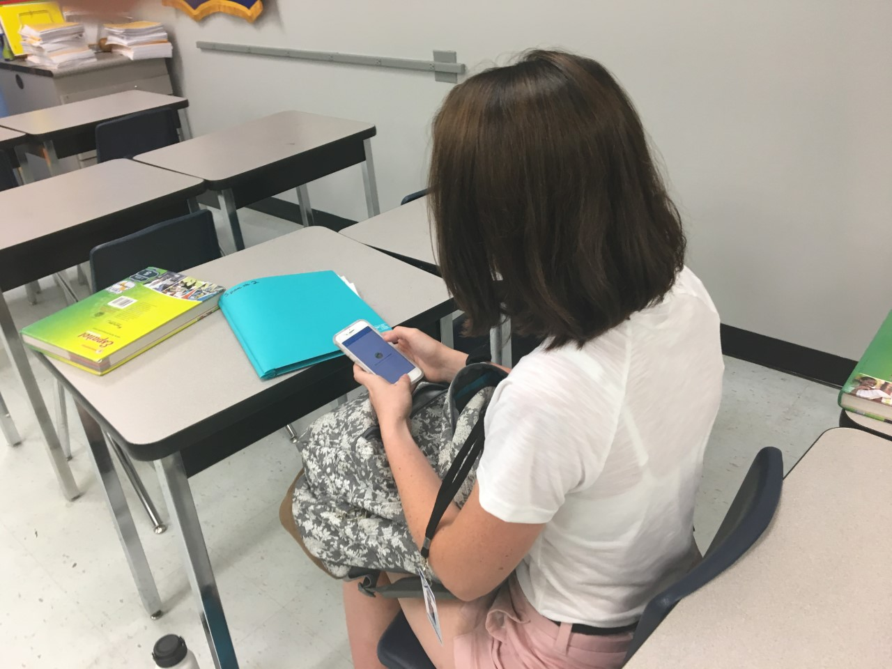 Sophomore Rebecca Rollins is checking School Messenger in between fourth period and lunch. She used the app to check if she had to do anything for Spanish or Key Club.
