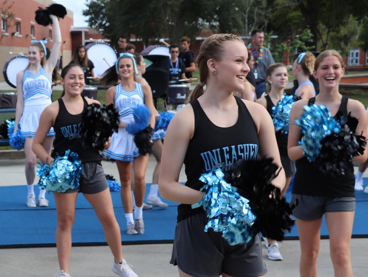 Cheerleaders and dance team members perform during the Husky Huddle on Aug. 30. Principal Robert Frasca has planned to make spirit events like this more of a regular thing.