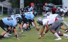 Both the offensive and defensive lines for Hagerty and Gateway respectively line up on the line of scrimmage, getting ready to rush the other side. Hagerty would go on to win 23-0.
