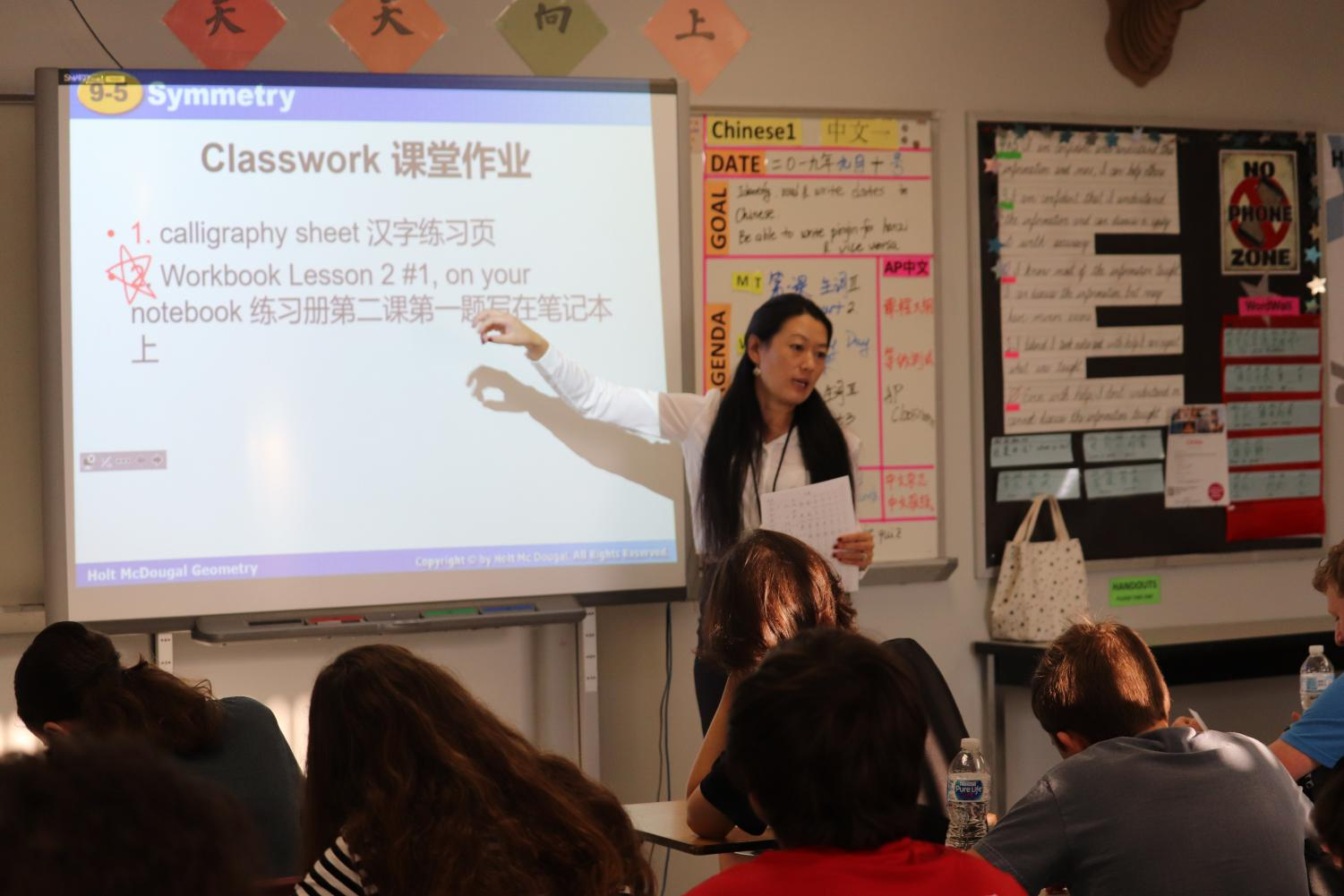 Zhang explains the directions to a calligraphy activity the class is doing.  Calligraphy is a traditional art form popular in China.