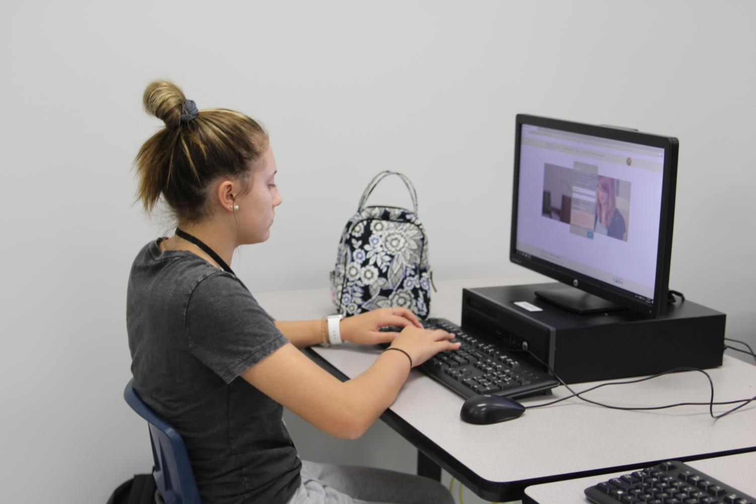 Freshman Lola Navarro works on her online Spanish course. Recent changes in the FLVS virtual system have caused uncertainty for the long-term future of the program.