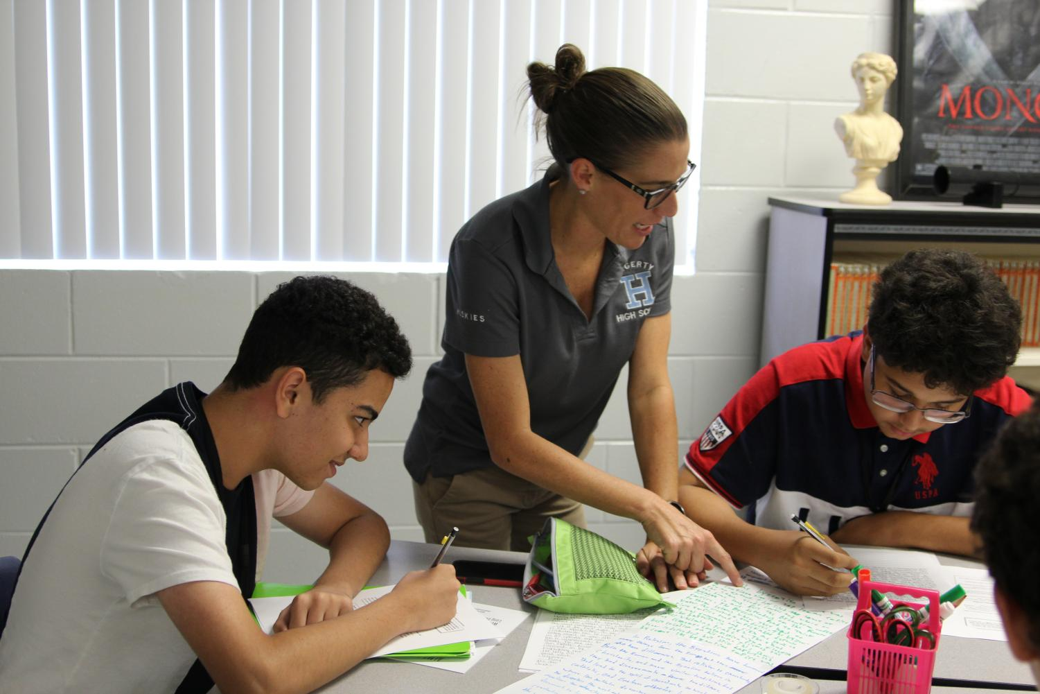 AP World History teacher Erin Foley helps sophomores Hakim Aburrashid and Diego Garcia with an assignment.