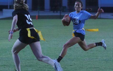 Junior Grace Truong runs the ball down the field in pursuit by a senior middle player. This play resulted in the juniors second touchdown.