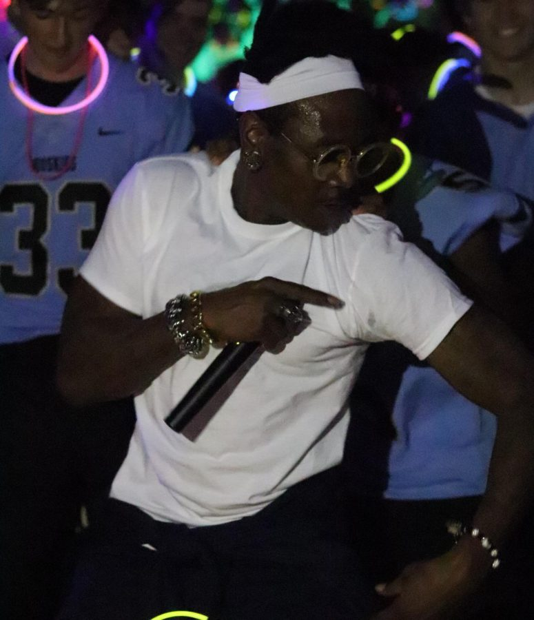 A member of the bass boyz dancing with the football team.