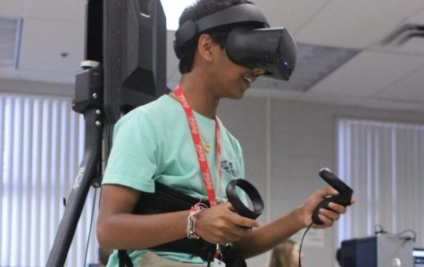 Junior Saagar Shah uses the KAT Walk VR to play a game he created. In June 2019, the Hagerty Modeling and Simulation program won $3,000 in new technology including the KAT Walk VR.