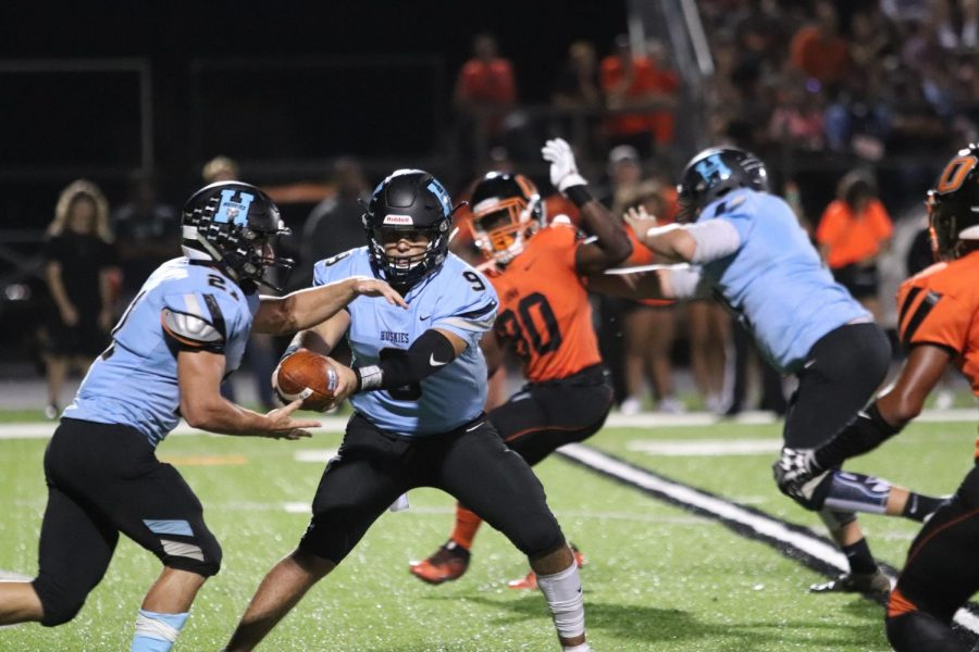 Running back Josh Bazzocco rushes the ball up the middle.
