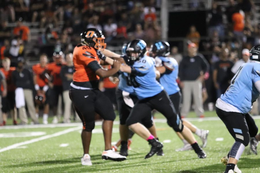 The Hagertys defensive line attempts to get past Oviedos offensive line.