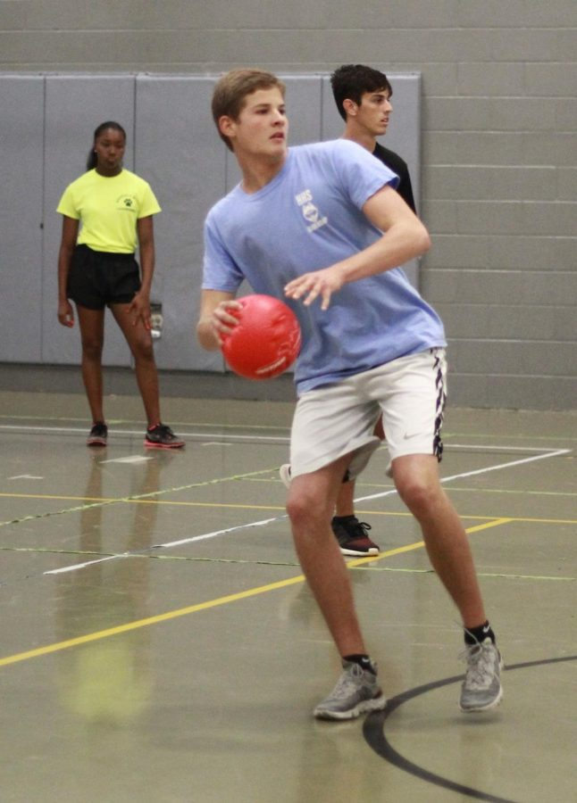 Junior Joshua Hobbs prepares to launch the dodgeball at the opposing team. Hobbs ' favorite part of the game was the mini student section created for another dodgeball team.