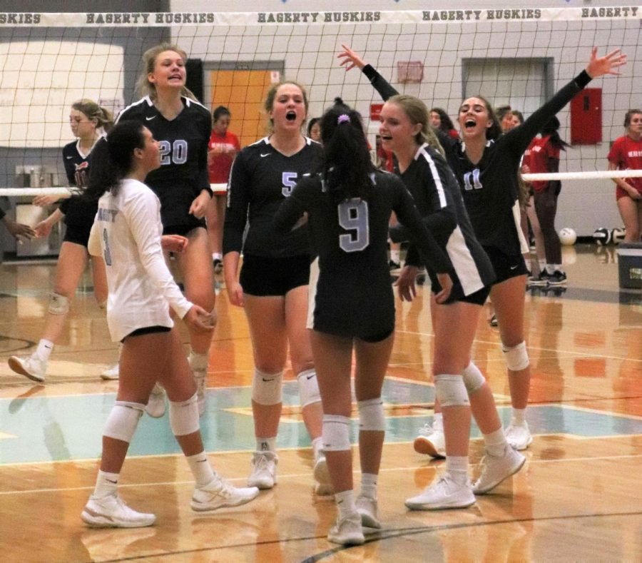 Girls+varsity+volleyball+celebrates+a+five-set+win+against+Leon+on+senior+night+on+Friday%2C+Oct.+11.++Leon%2C+the+team+that+beat+Hagerty+in+the+state+semifinals+two+years+ago%2C+was+ranked+number+one+in+the+state+before+losing+to+Hagerty.