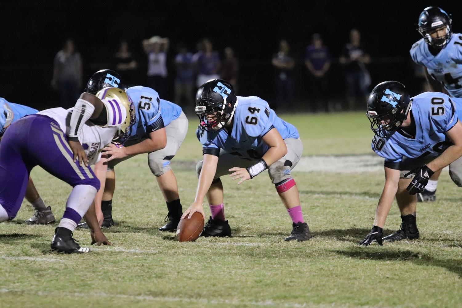 Sophomore center Chase Horne prepares to snap the ball to junior quarterback J.J. Baird