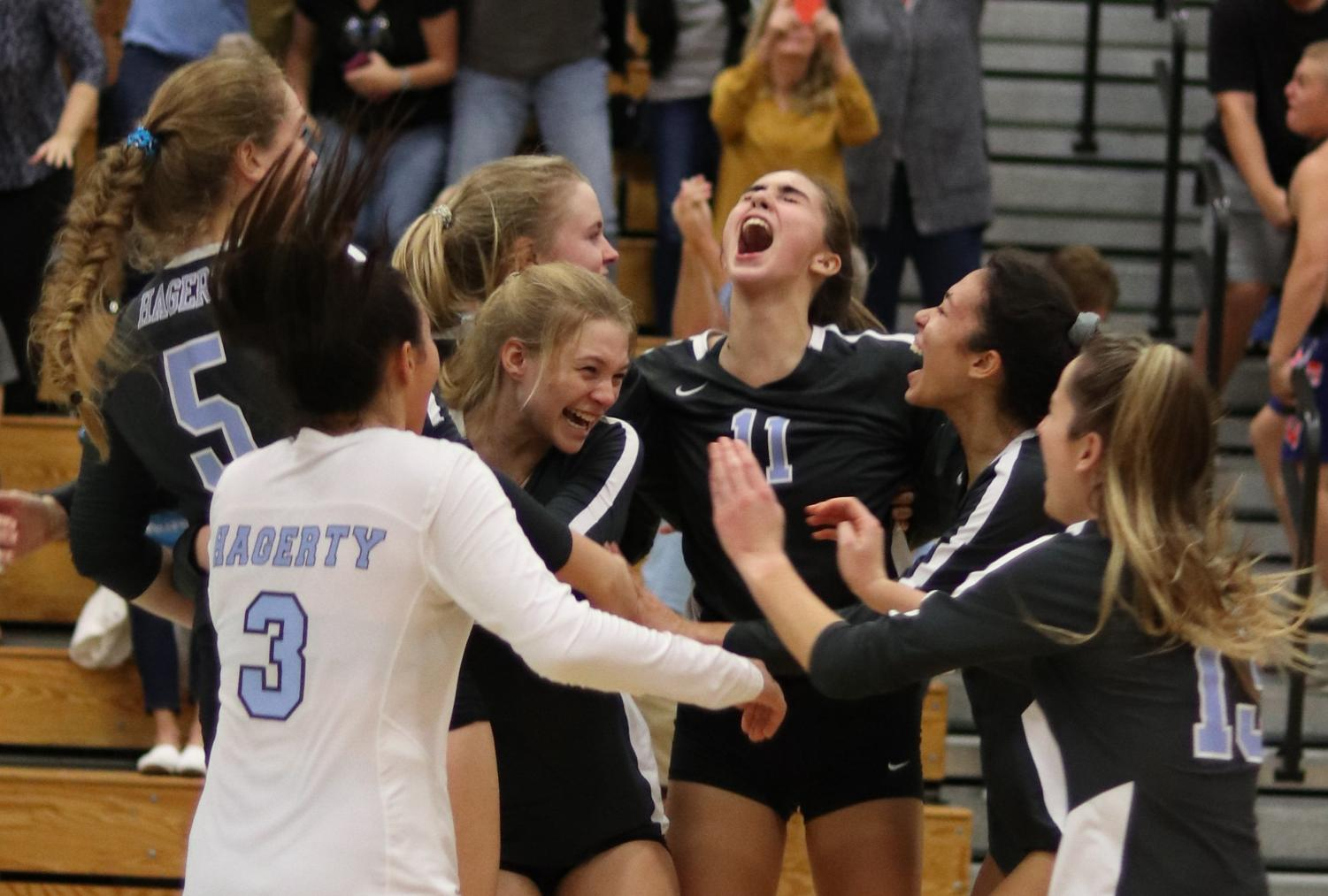 The varsity girls volleyball team celebrates after beating Lyman 3-2. The team will play Saturday, Nov. 9 against Plant High for a chance to get to the state final.