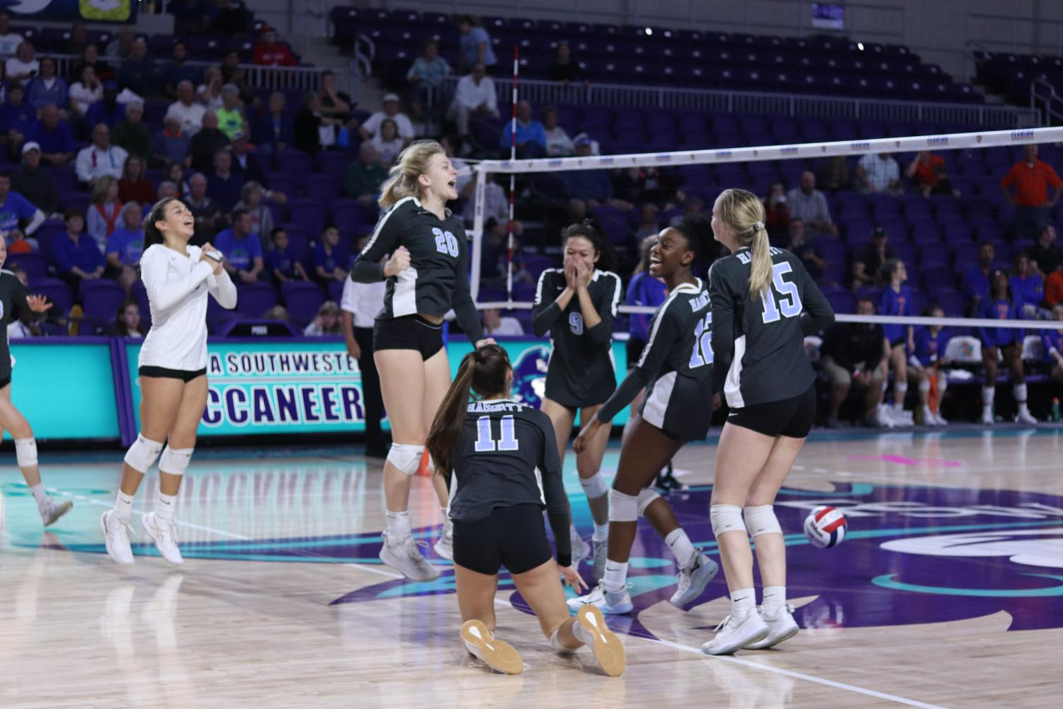 The girls volleyball team celebrates match point against Palm Beach Gardens. The team won its first state championship on Saturday, Nov. 16.