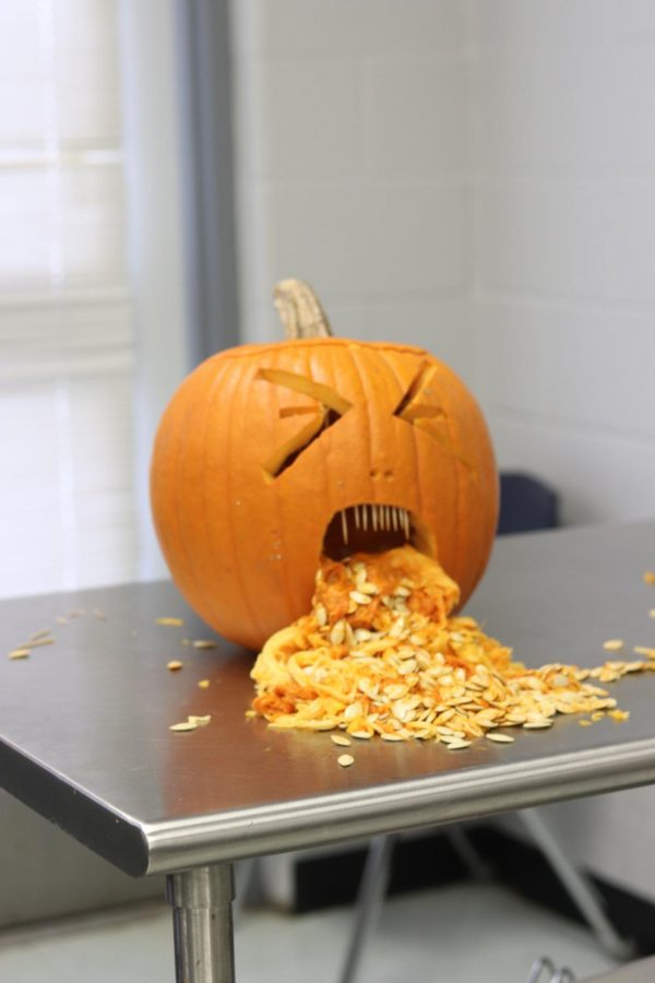 Pumpkin+spilling+guts+from+its+mouth+with+a+disgust+face