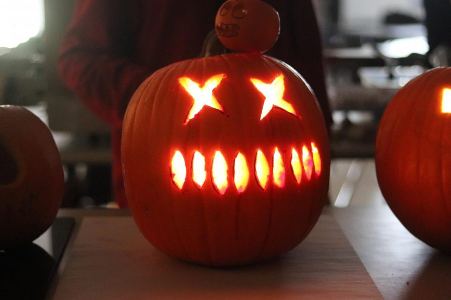 Pumpkin with x's for eyes and large teeth