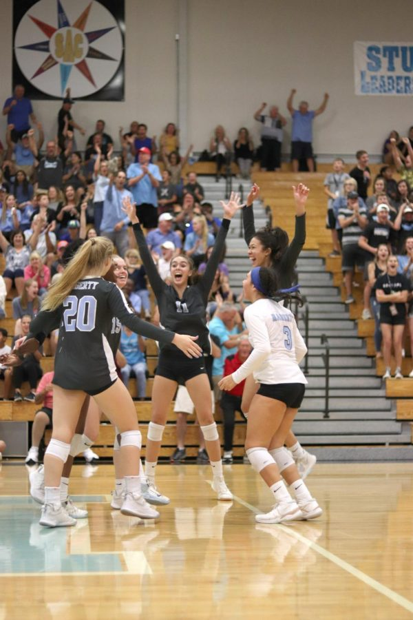 Setter+Emily+Lawrence%2C+libero+Alondra+Garcia+and+others+celebrate+during+the+Plant+game+on+Oct.+22.+The+team+won+in+three+sets.+