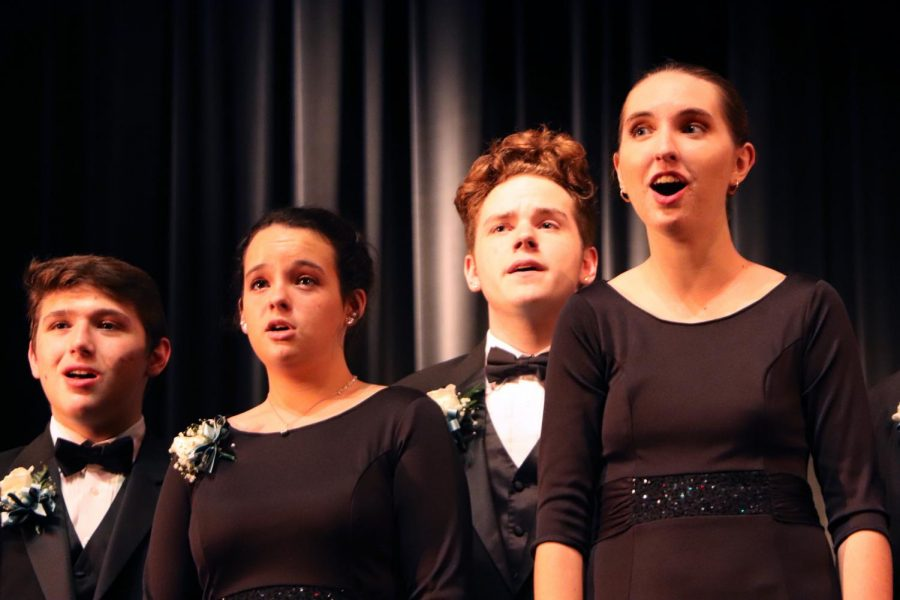 Seniors Adam Johnson, Haleigh Strickland, Evan Bogert and junior Olivia Martin sing Rejoice with Exceeding Great Joy by Charlotte Richie, Reggie and Love Smith.