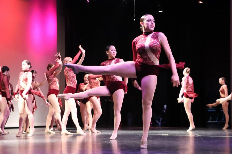 Junior Marianna Perez performs a group dance piece at the showcase among her fellow varsity dancers.