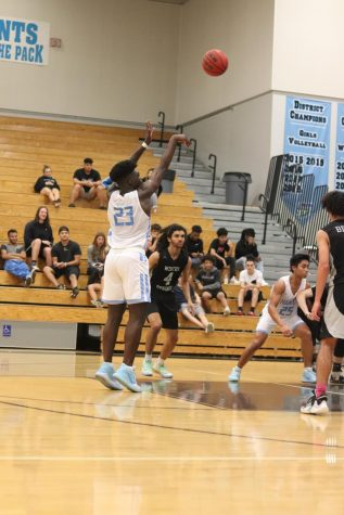 Sophomore guard Jah Nze pulling up on the top of the key vs Winter Springs. He was one of seven athletes honored at the day.