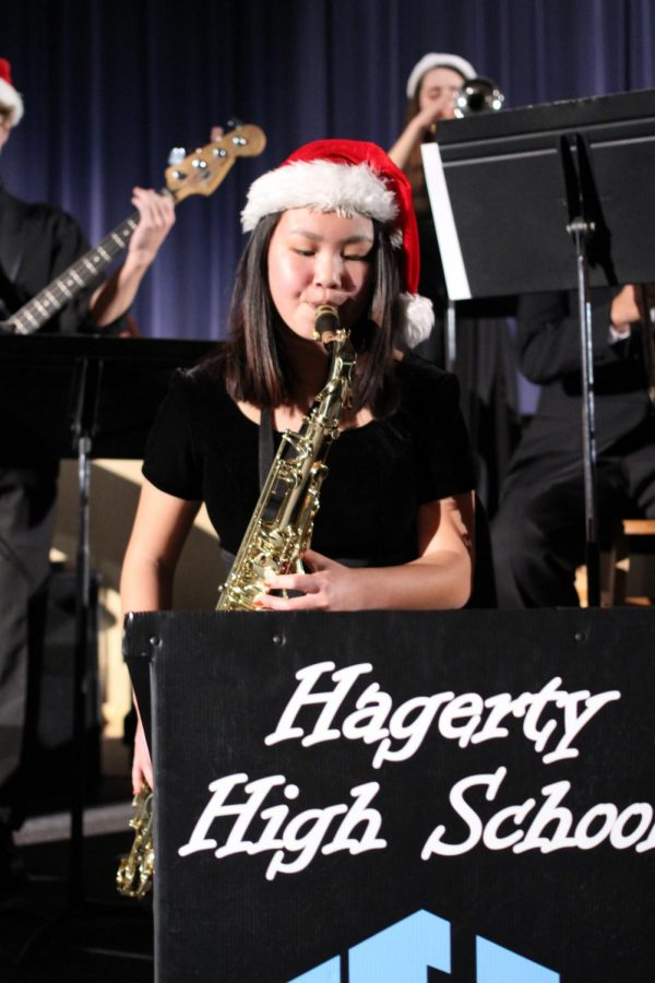During Rhapsody in Blue, junior Olivia Schultz plays tenor sax during the opening number for the Jazz band,