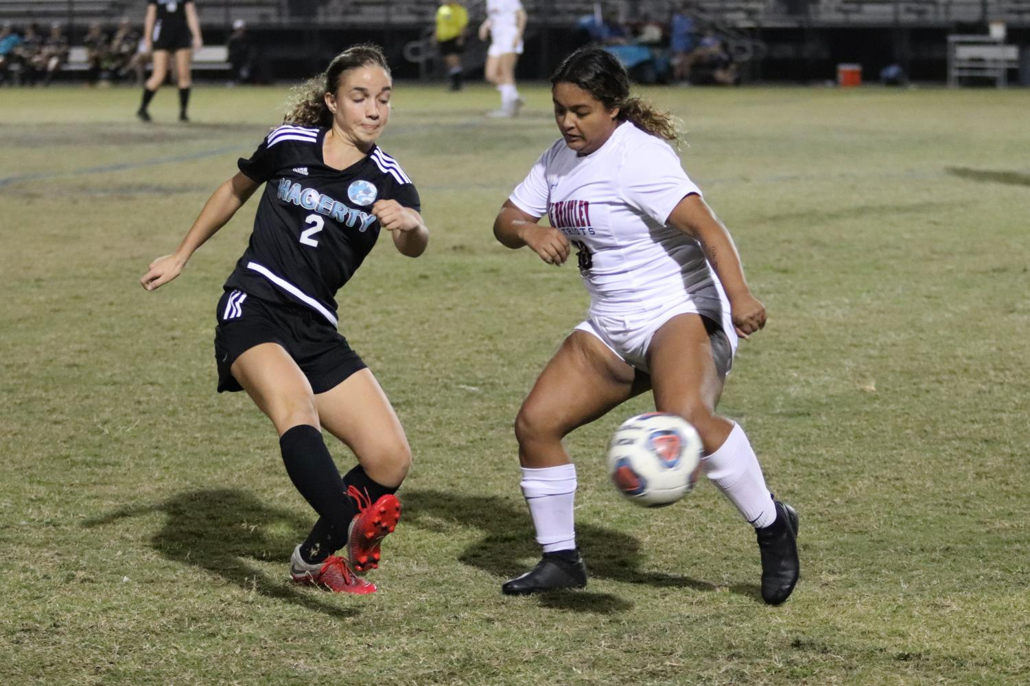 Midfielder Rachel Pyros passes the ball around a Lake Brantley defender in the first half of the Dec. 10 soccer match. The team lost the match 3-0.