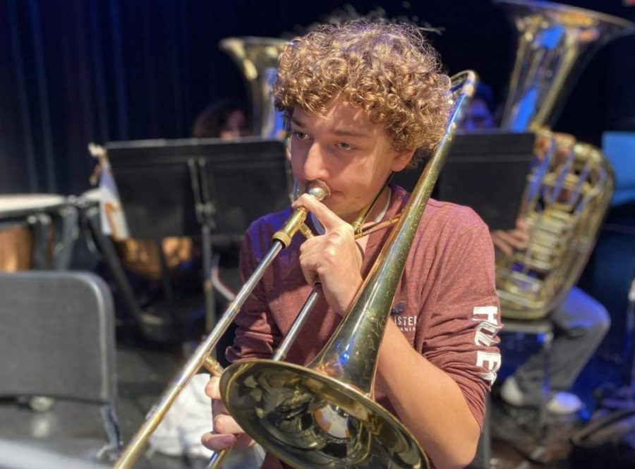 Trombone player Cameron Mostecki practices music he will play in Germany. He is part of the 75-person group that left on Saturday, Dec. 14.