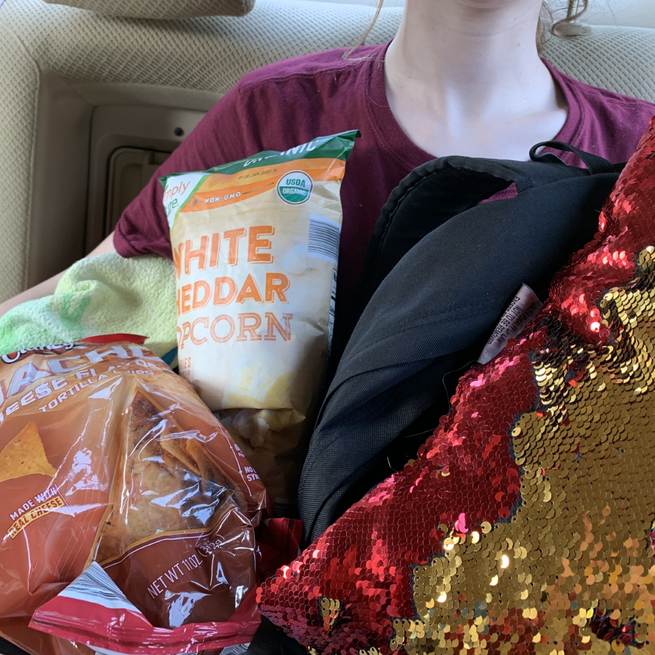 Pillows, backpacks, snacks, and blankets are some of the items that can crowd personal space during a long car trip. With no space, it can be hard to fall asleep.
