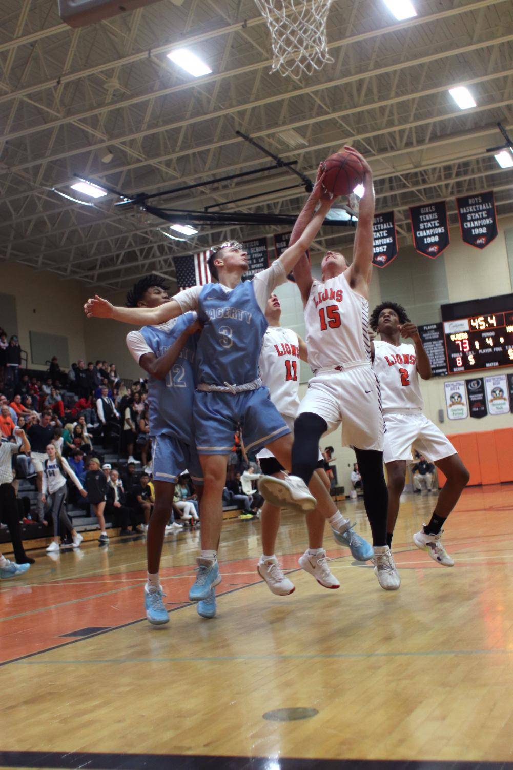 Foward Tyler Pate attempts to rebound a ball against an Oviedo off ender. The team would lose that game, 52-72.