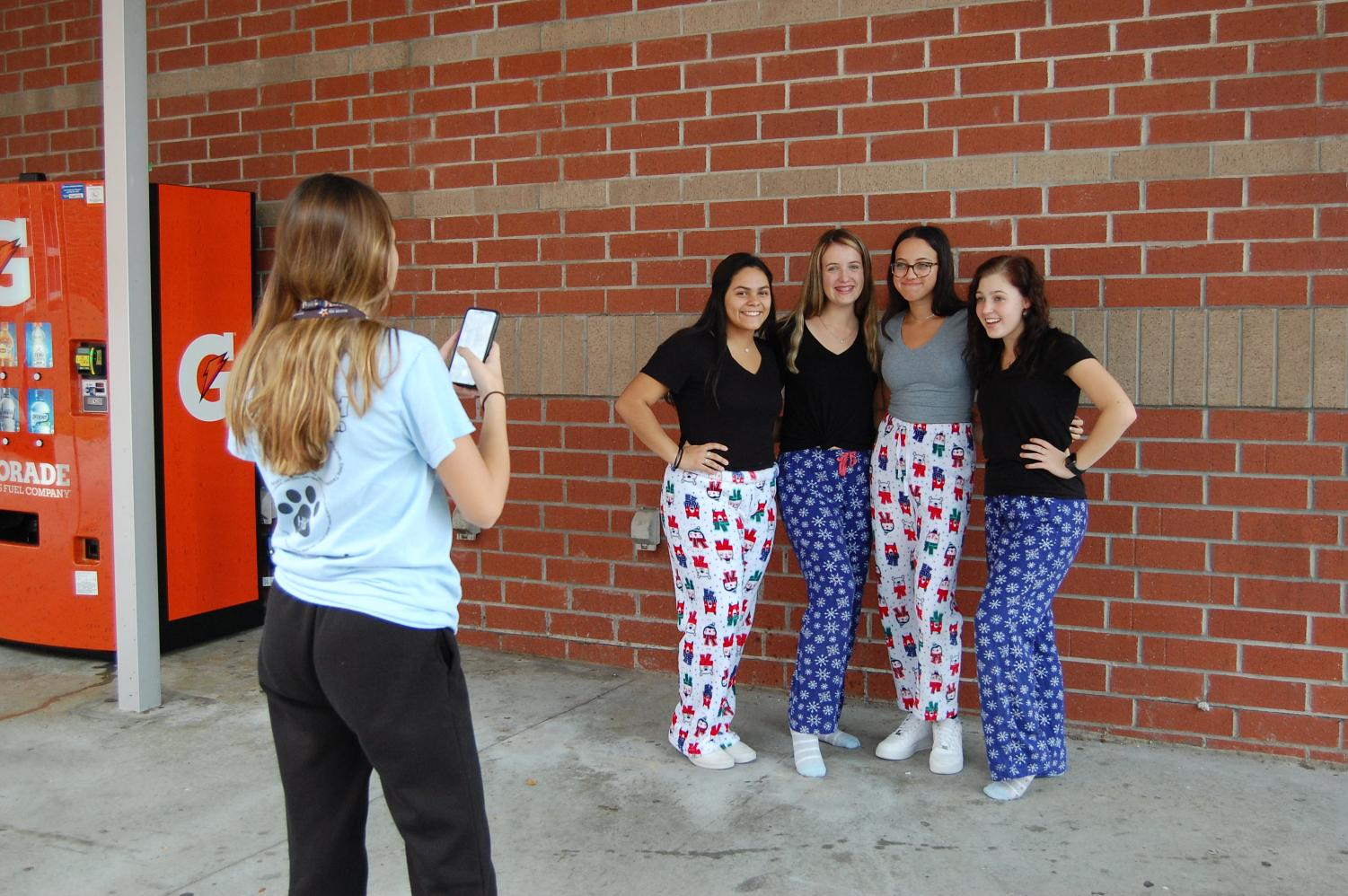 Friends gather all throughout Winter Week to take photos for each themed day. This was pajama day.