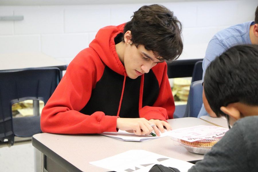 Senior Brian Gifford works on a test for AP Calculus after school.