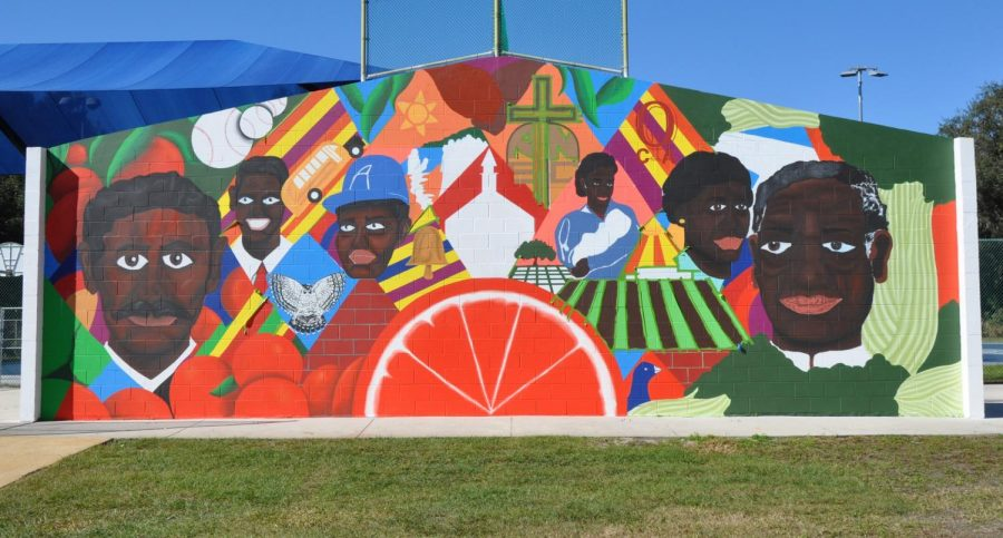 Alumni Xavier Moss' Round Lake Park mural days before the unveiling on MLK Day.