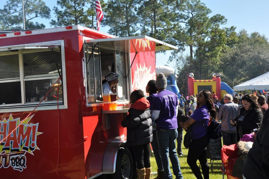 Many people lined up at many food trucks to get ice cream, italian ice, barbecue and more.