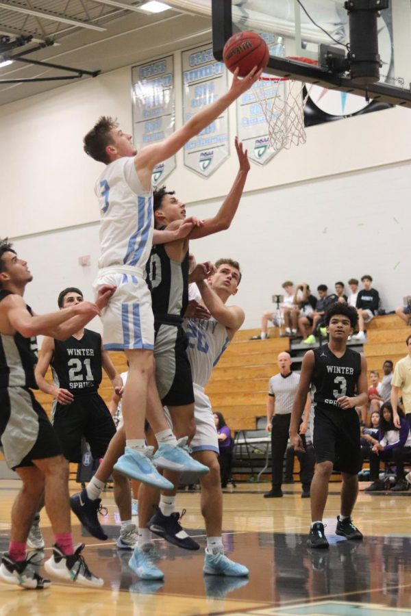 Senior Tyler Pate grabs a rebound in a game against Winter Springs. Pate hit the game-winning three in Wednesdays win over Oviedo.