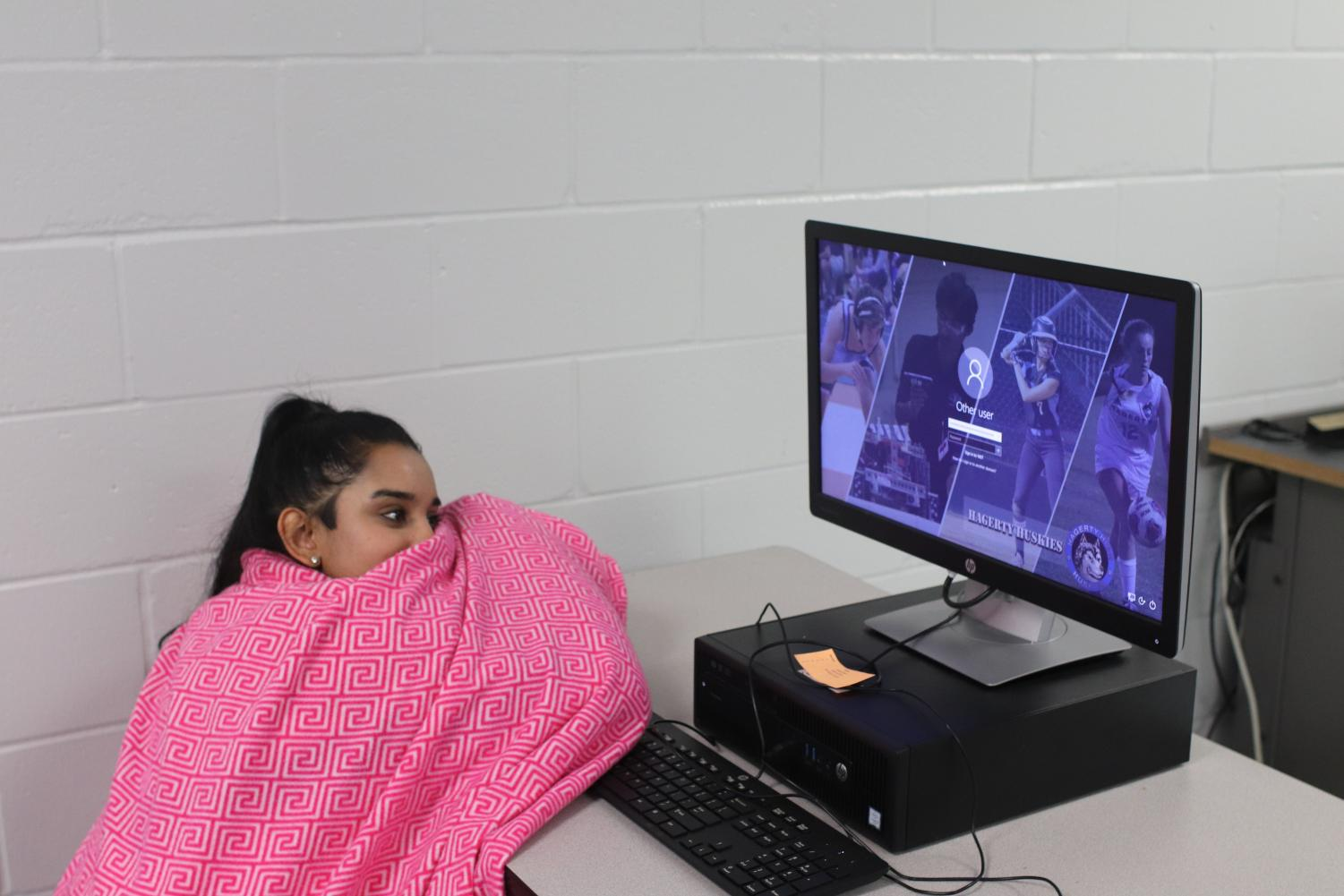 Senior Ashley Sharma learns in her sixth period. The class was cold and frigid so she had to get a blanket to be comfortable.