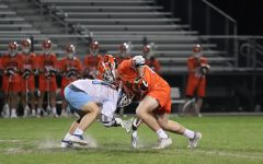 Senior Christian Hofer faces off against Oviedo player at the game on March 5, 2020. Hagerty loss the game 6-8.