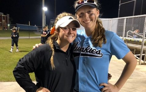 Hagerty and Oviedo students, Zoe Thornsbury(right) and Ava Bassani(left) take pictures together after their game. The Hagerty varsity softball team beat Oviedo 5-1.