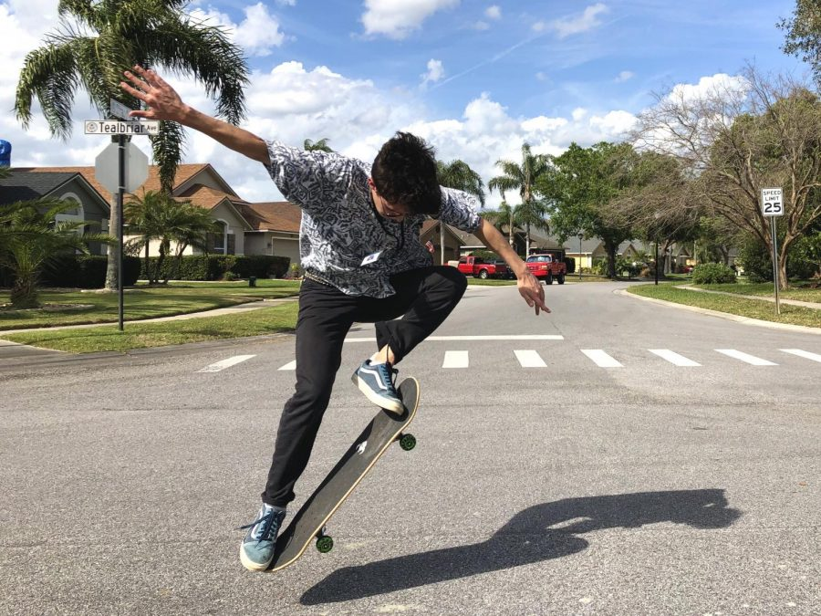 Junior+Jackson+Schwerdt+performs+an+ollie%2C+a+popular+trick+many+skateboarders+learn.+He+usually+practiced+a+few+times+a+week+for+a+couple+hours.