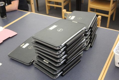 Laptops sit in the media center waiting for community members to pickup. SCPS staff passed out Hagerty laptops to students from elementary, middle and high school students from schools across the county.