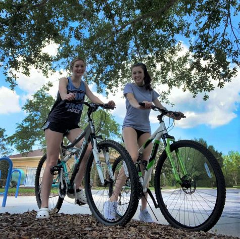 "Junior Madison Drewry and her younger sister Macy take an afternoon bike ride together on April 9 around the Live Oak Reserve. ""It"