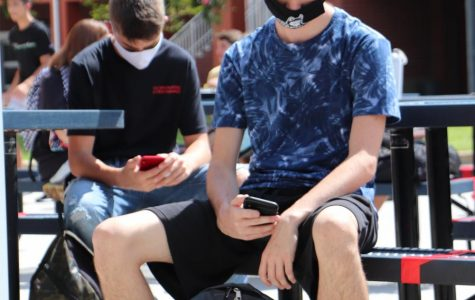 Junior Jacob Leggio wearing a mask during lunch on the first day of school.